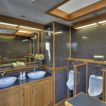 Load image into Gallery viewer, platinum restroom trailer with wood and marbled walls