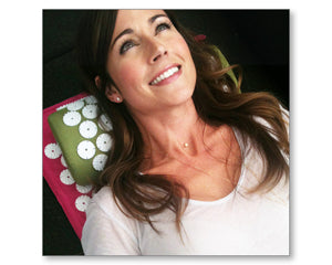 Nikki Deloach greyson chance on bed of nails acupressure mat and pillow products benefits include pain management stress relief mindfulness healthy modern day acupressure session at home @greysonchance