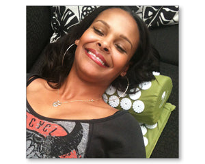 Samantha Mumba on bed of nails acupressure mat and pillow products benefits include pain management stress relief mindfulness healthy modern day acupressure session at home