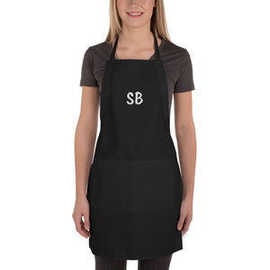 Female model wearing apron black