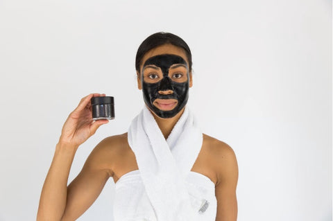 Woman Holding Black Skincare Mask