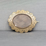 Victorian Braided Hair Brooch in 14k Yellow Gold Engraved Frame