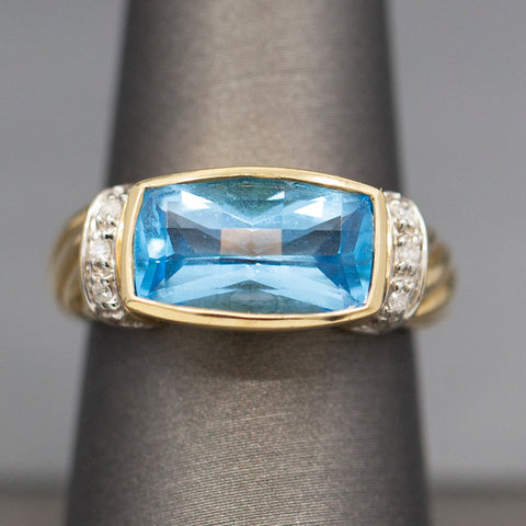 Bright Blue Topaz and Diamond Accent Twisted Cable Ring in 10k Yellow Gold