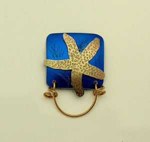 Hand Engraved Bronze Starfish on Blue or Green Square Magnetic Eyeglass Holder - Laura Wilson Gallery