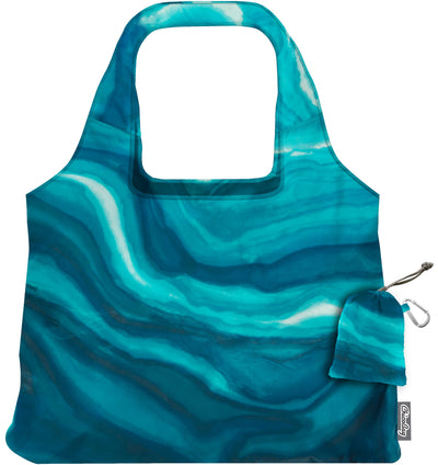 ChicoBag Vita Blue Watercolor Waves Print Polyester Reusable Shoulder Tote That Stuffs Into its built-in pouch On a White Background