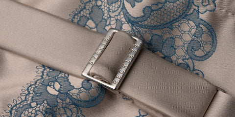 Image of luxury Italian woven lace jacquard and custom-branded metal hardware used in Tragic Kiss luxury lingerie