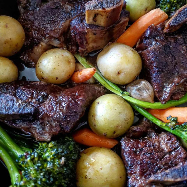 An up-close image of the braised short ribs recipe, showing details of the meat