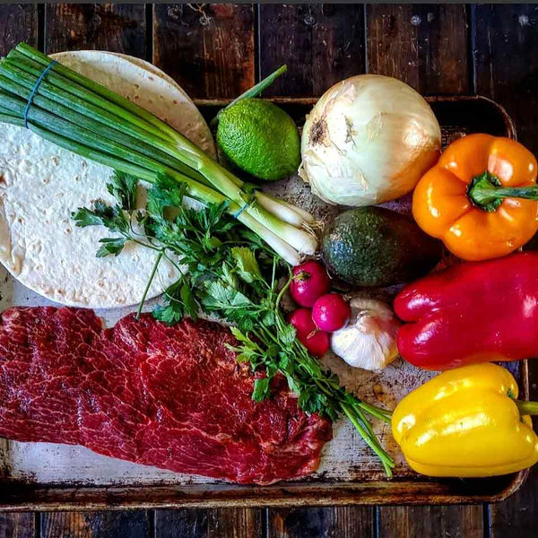 An image of all the ingredients that go into sheet pan steak fajitas
