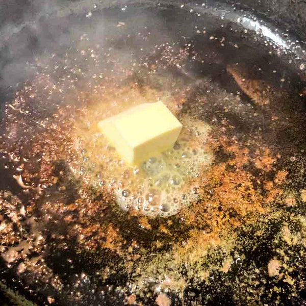 Melt butter in the pan to prep for a flavorful roast
