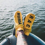 ADIDAS HUMAN RACE YELLOW