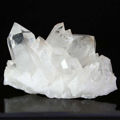 Raw quartz crystal cluster specimen