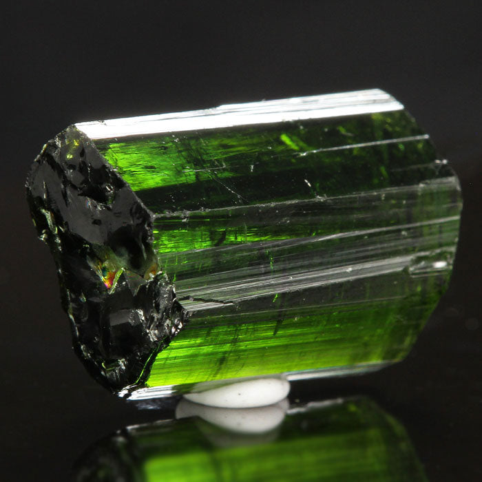 Raw green tourmaline crystal gemmy