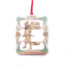 Load image into Gallery viewer, Annie Oakley Aim High christmas ornament gold metal cutout sharp shooter national cowboy and western heritage museum store holiday ornament for 2015 collection collectible