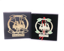 Load image into Gallery viewer, coming through the rye national cowboy museum collectible holiday ornament 2013 cowboys on horseback gold metal christmas tree ornament and box