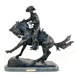 The cowboy bronze sculpture replica by frederic remington
