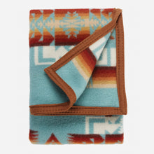 Load image into Gallery viewer, Pendleton Woolen Mills crib blanket Chief Joseph aqua baby Nez Perce warrior strength integrity honor Native American soft wool children gift holiday warmth folded