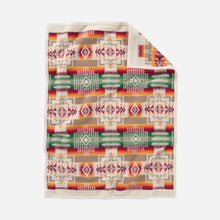 Load image into Gallery viewer, pendleton woolen mills chief joseph crib blanket baby gift shower cuddle cozy white cream ivory pattern red orange green sleeping child back side