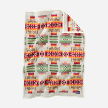 Load image into Gallery viewer, pendleton woolen mills chief joseph crib blanket baby gift shower cuddle cozy white cream ivory pattern red orange green sleeping child front side