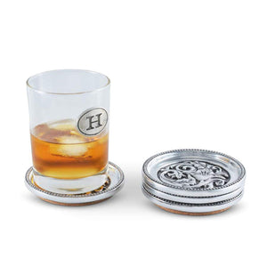 Arthur Court and Vagabond House concho cactuc flower coaster set drink set of 4 silver design southwestern home goods stacked with a glass of whiskey