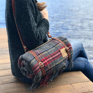 Near a lake with the Pendleton Woolen Mills Motor robe with leather carrier slung over shoulder to keep warm cozy