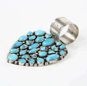 Turquoise heart pendant Rocki Gorman bold statement jewelry women western southwestern blue side view