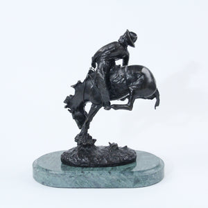 The Outlaw bronze sculpture replica statue by Frederic Remington cowboy on a bucking horse saddle breaking back