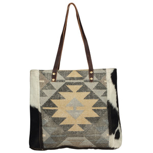 myra bag handbag tote quaint canvas rug and hairon cow hide black and white big bag laptop purse geometric pattern