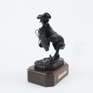 The Rattlesnake bronze sculpture replica statue by Frederic Remington cowboy on horseback snake scared side view