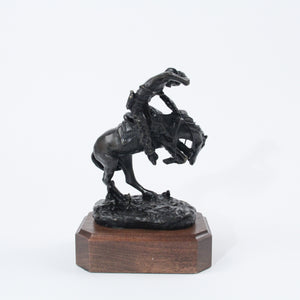 The Rattlesnake bronze sculpture replica statue by Frederic Remington cowboy on horseback snake scared back side view