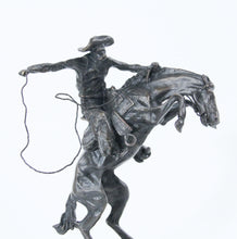Load image into Gallery viewer, Wooly Chaps boncho buster frederic remington sculpture replica bronze wooden base