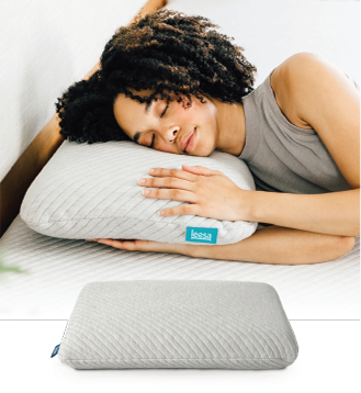 woman laying on premium foam leesa pillow