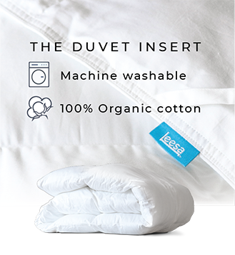 the duvet insert - white down alternative duvet insert/comforter with corner loops laying on bed - folded comforter duvet insert