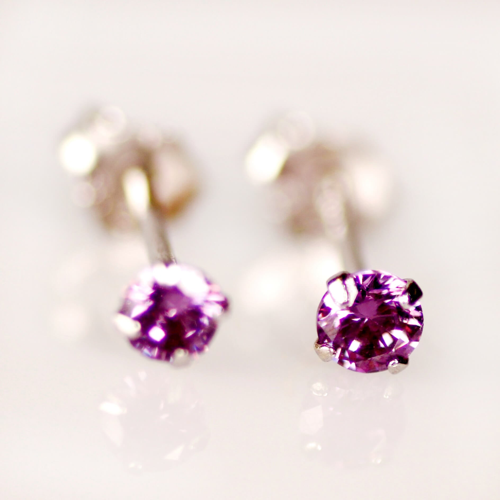 Tiny CZ stud earrings