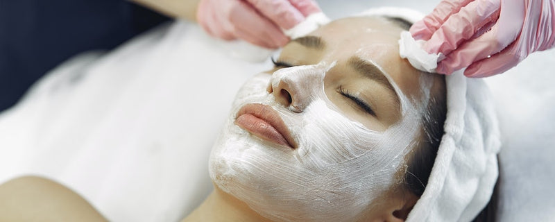 woman in spa getting facial mask