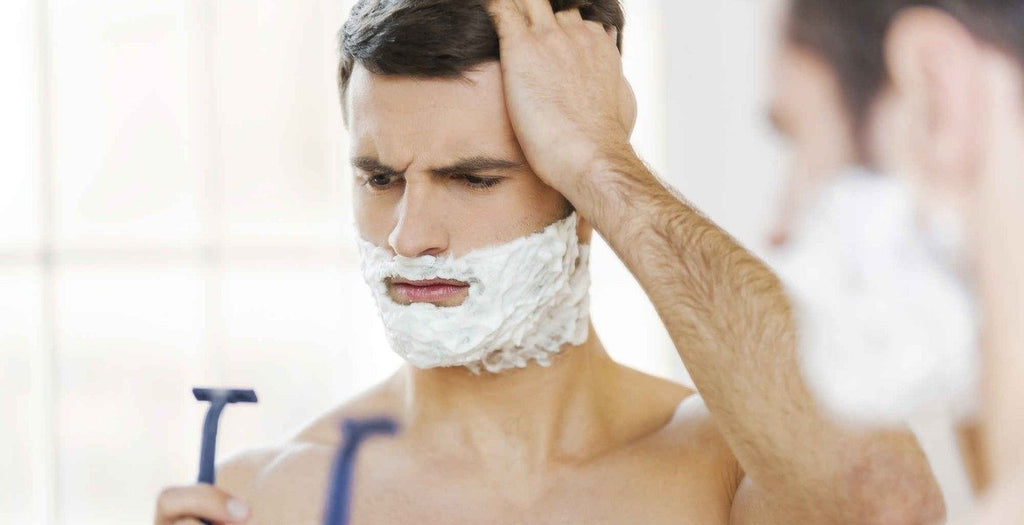 Man looking confused shaving face|Man Post Shave in Mirror|Shaving Cut|Man Wet Shaving|Man applying aftershave|Man having wet shave in barbers|Shaving kit for men|How to heal shaving cuts|D.R. HARRIS Safety Razor 3 Part Ivory
