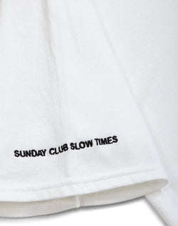 The Idle Man -Sunday Club Slow Times Pec Embroidered T-Shirt Navy (small text)