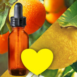 Essential Oil Signature Scent | Citrus Blend | The background is made up of images of orange and lemon fruits hanging on branches with leaves on them. A glass amber dropper bottle in the foreground. A bright yellow heart at the bottom of the image signifies the signature Citrus scent.