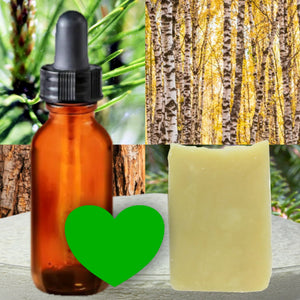 Essential Oil Acadian Forest Signature Scent + Laundry Powder + Stain Bar - Great Value Combo! Background shows a bowl with laundry powder heaped up, balsam and pine needles on twigs, birch forest in autumn, cedar bark, stain bar, glass amber eye drop bottle. A forest green heart in the foreground signifies the Acadian Forest scent.