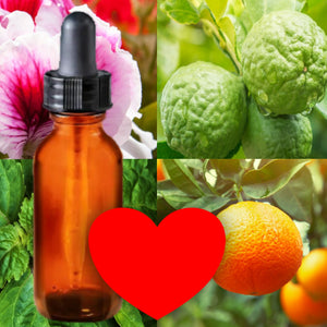 Essential Oil Signature Scent | Be Mine Blend with Patchouli | The background is made up of images of geranium blossoms, patchouli leaves, orange and bergamot fruits on tree branches with leaves. A glass amber dropper bottle is in the foreground. A red heart at the bottom of the image signifies the signature Be Mine scent.