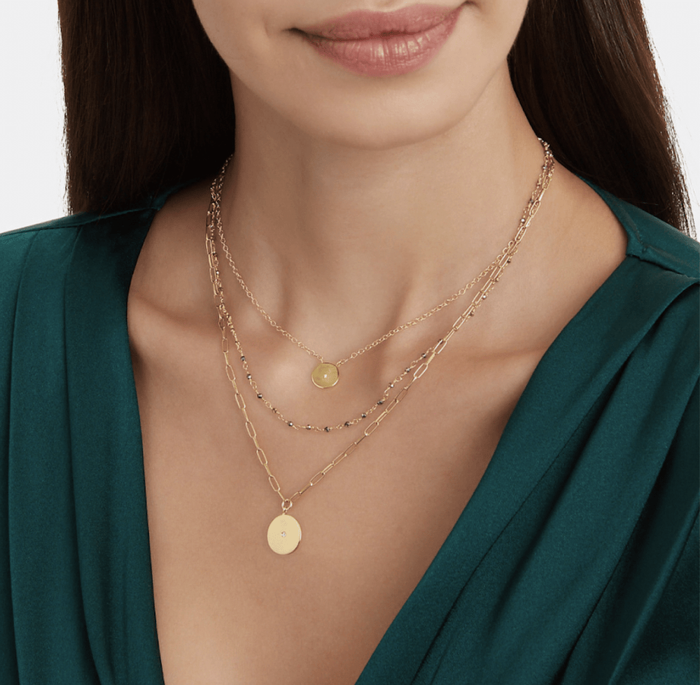 ela rae lara three in one disc necklace pyrite 14k yellow gold plate model