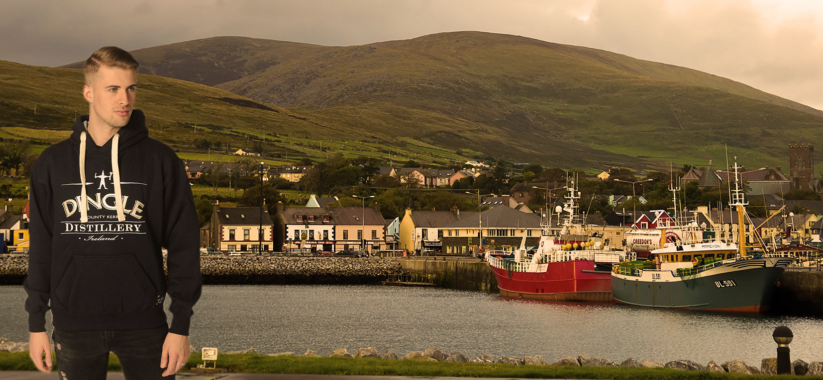 Dingle Distillery Hoody with Dingle town and Harbour in the background