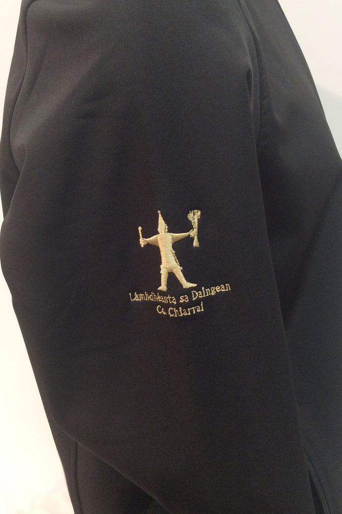 Close up of the Dingle Distillery Soft Shell Jacket gold embroidered logo on the right arm, in our leisure wear clothing collection, with full zip