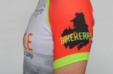 A man wears the short sleeve Dingle Bike Kerry Cycling Jersey with a close up on the Bike Kerry logo