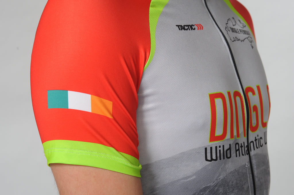 A man wears the short sleeve Dingle Bike Kerry Cycling Jersey with a close up on the Irish flag