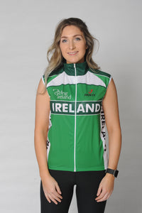 A woman wears the Team Ireland Short Sleeved cycling jersey which is green with white panels and sports the Spin 11 and Cycling Ireland logos