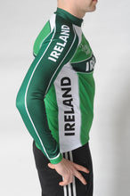 Load image into Gallery viewer, Side view of the Team Ireland Long Sleeved cycling jersey which is green with white panels and sports the Spin 11 and Cycling Ireland logos