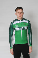 Load image into Gallery viewer, A man wears the Team Ireland Long Sleeved cycling jersey which is green with white panels and sports the Spin 11 and Cycling Ireland logos