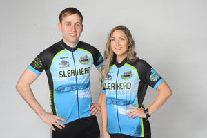 A man and a woman wearing the short sleeved Slea Head Bike Kerry Short Sleeve Cycling Jersey