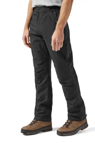 A man wears black waterproof sportswear trousers