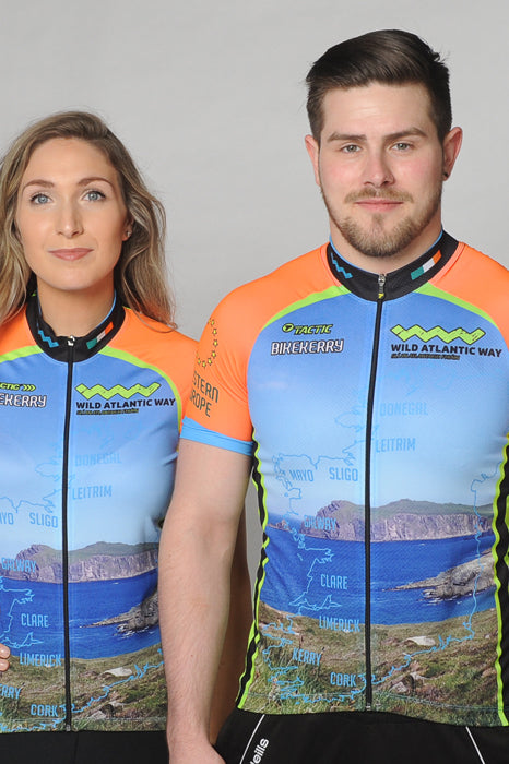 A man and a woman wearing the short sleeve Wild Atlantic Bike Kerry Short Sleeve Cycling Jersey